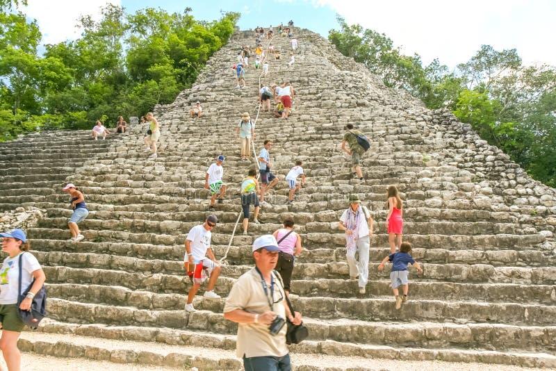 Climbing the pyramid at Coba. stock photos