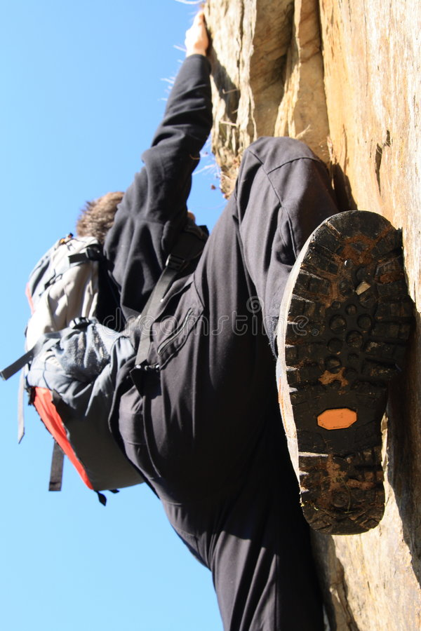 Climbing on a rock royalty free stock images