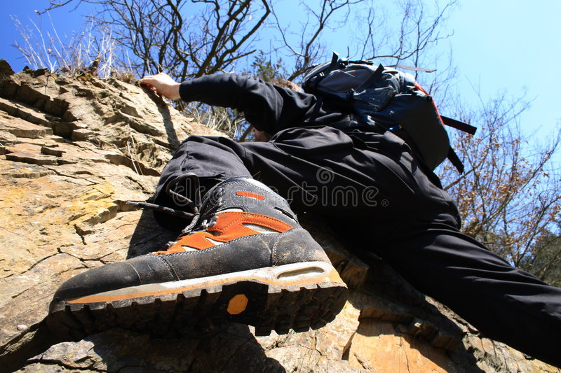Climbing on a rock royalty free stock photography