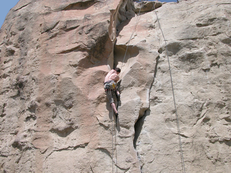 Climbing the Rock Wall royalty free stock photography