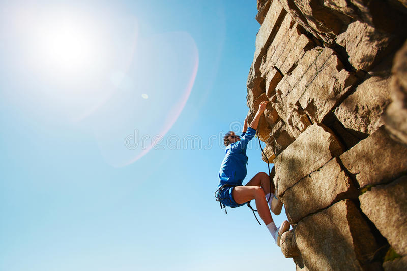 Climbing rock royalty free stock images