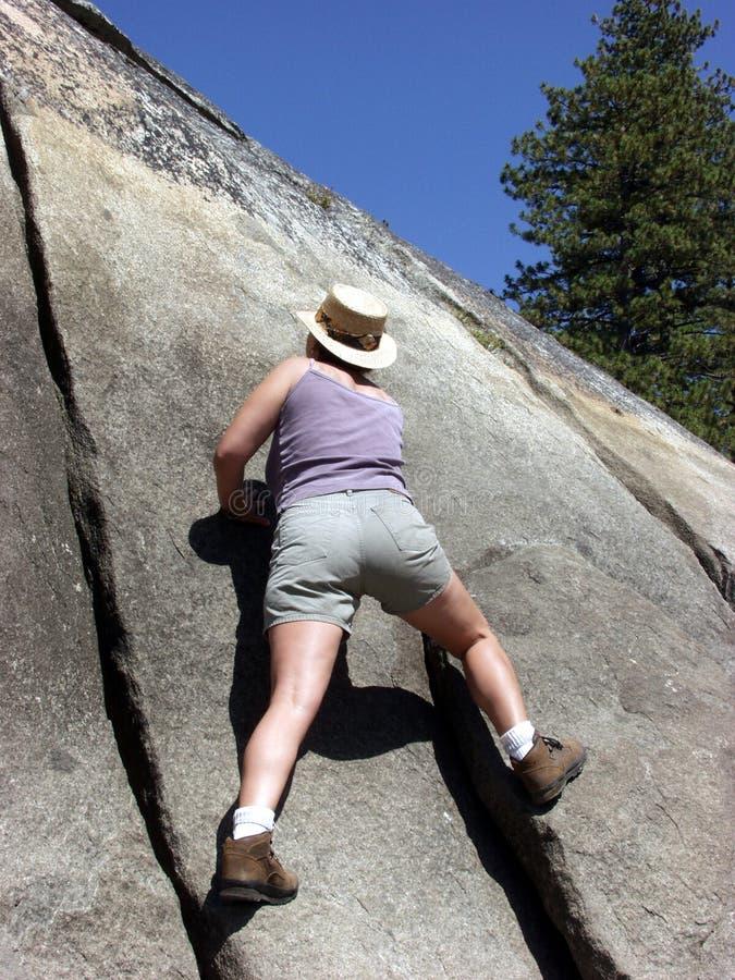 Climbing the rocks stock photography