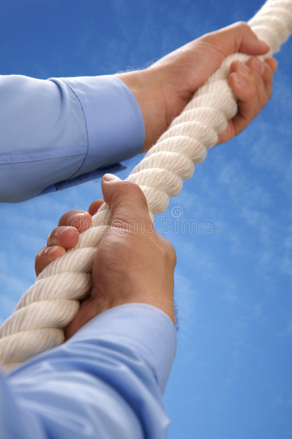 Climbing A Rope Royalty Free Stock Image
