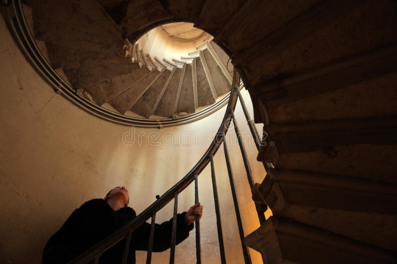 Climbing spiral staircase royalty free stock images