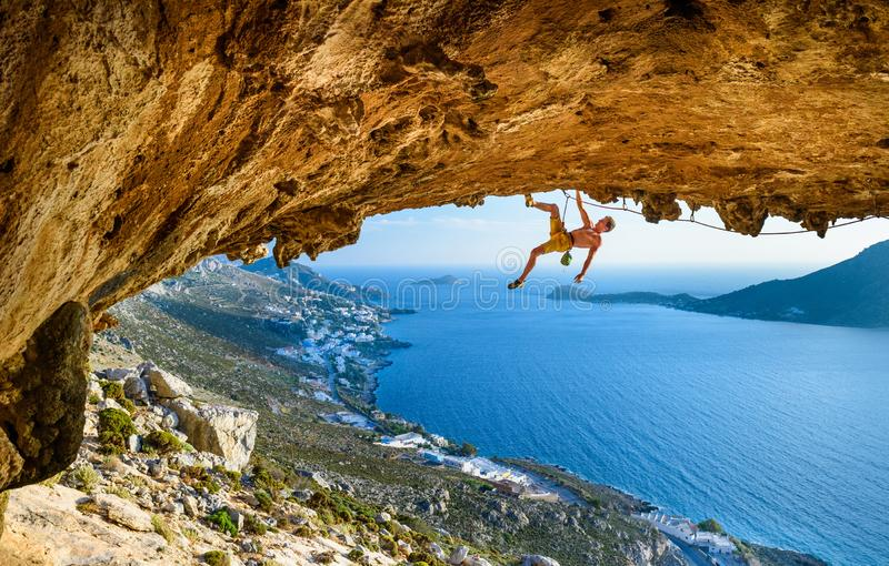 Climbing Sport fitness athlete on beautiful rocks.Travel destination Greece royalty free stock images