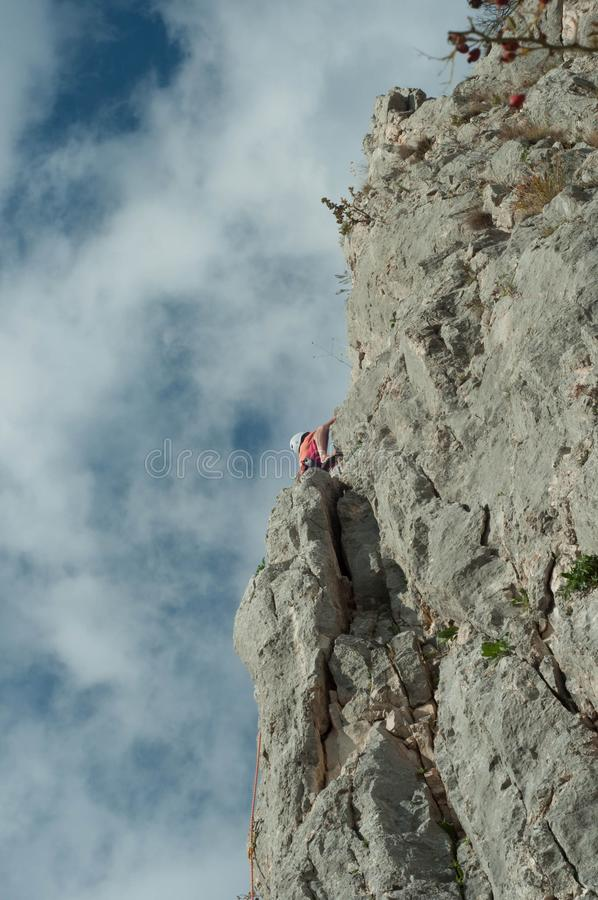 Climbing. On a sunny day in the mountains royalty free stock photos
