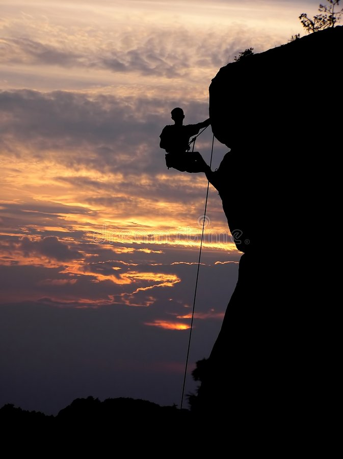 Climbing and a sunset. Rock climbing is my life royalty free stock image