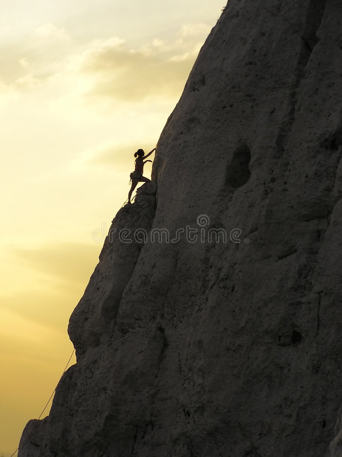 Climbing and a sunset. Relaxation, successful, recreation, exhausting, difficult, adrenalin, dangerous, mountains, adventure, vacation, exercise, athletic royalty free stock photography