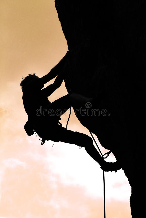 Climbing in the sunset royalty free stock image