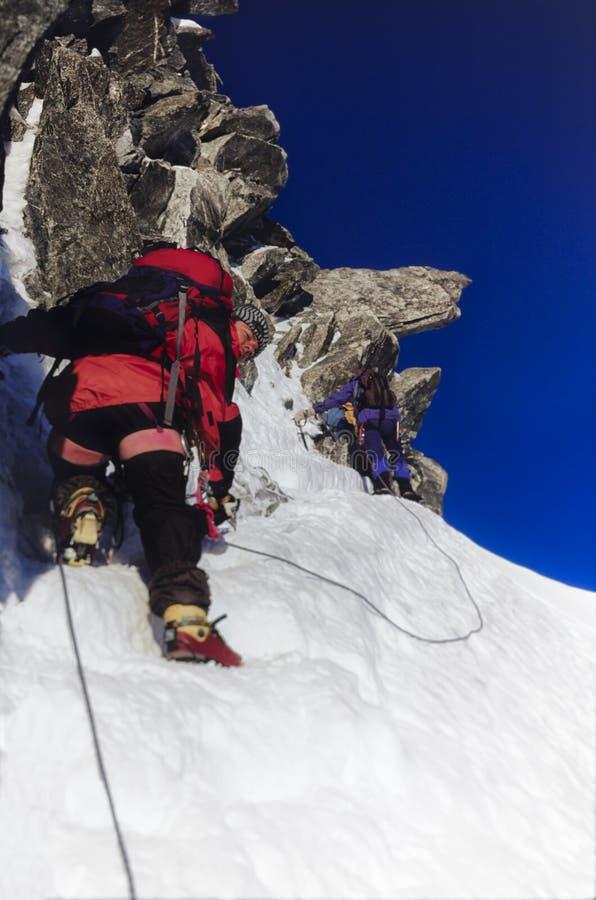 Climbing team on snow and rock royalty free stock photos