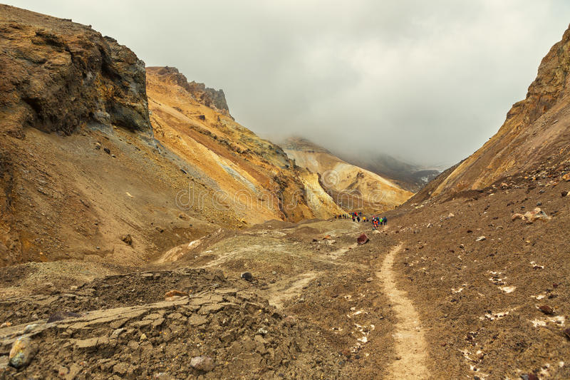 Climbing to active volcano Mutnovsky on Kamchatka. stock images