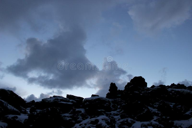 Climbing up lava to the clouds royalty free stock images