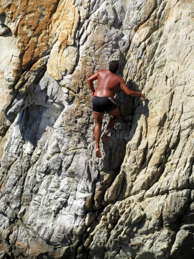 Climbing up the Rock Face royalty free stock photography