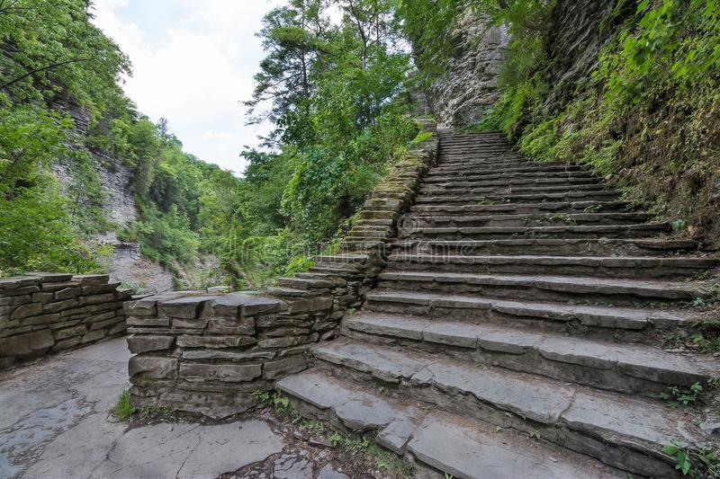 Watkins Glen State Park In Upstate New York. Climbing up a series of stone steps at Watkins Glen state park near Seneca Lake in upstate New York stock image