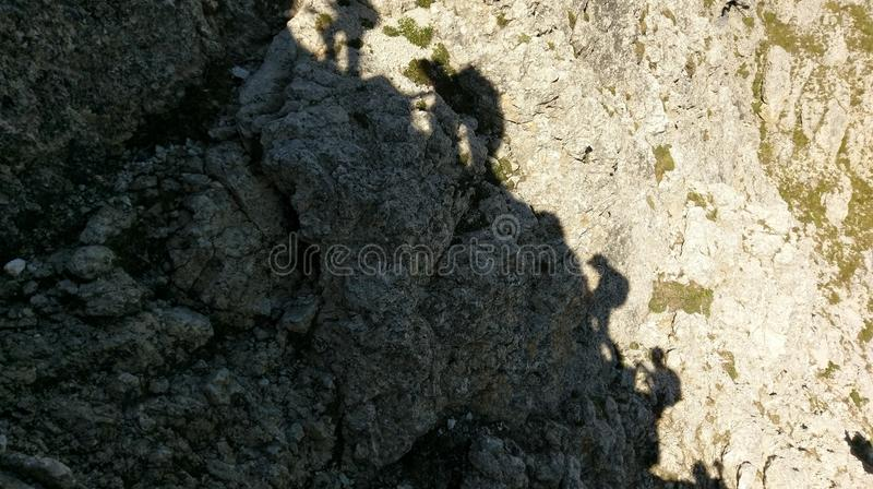 Climbing the via ferratta in the Dolomites royalty free stock images