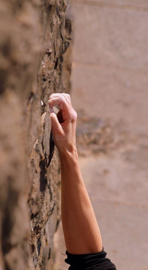 Climbing a wall stock photos