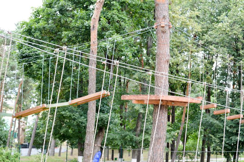 A climbing wall, trolls and a rope park are sporting for games and entertainment from boards and trees with ropes for playing royalty free stock photography