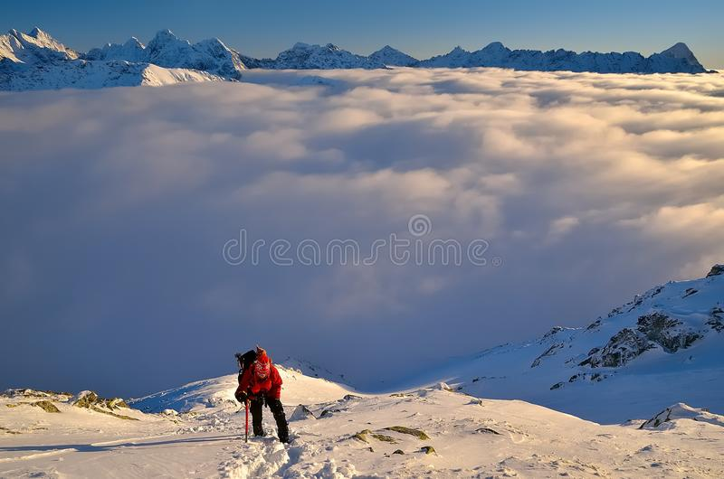 Climbing in winter mountains royalty free stock photo