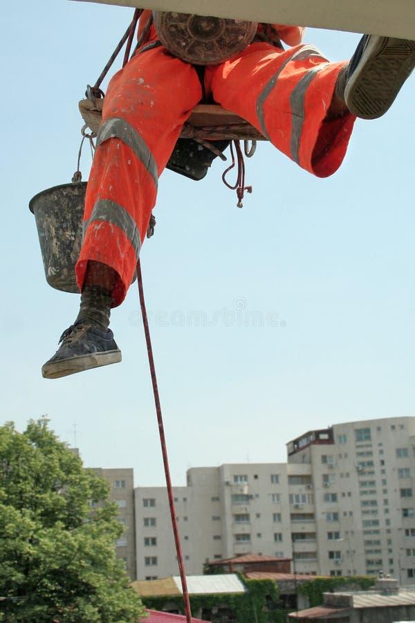 Climbing Worker - Facade Repair stock image