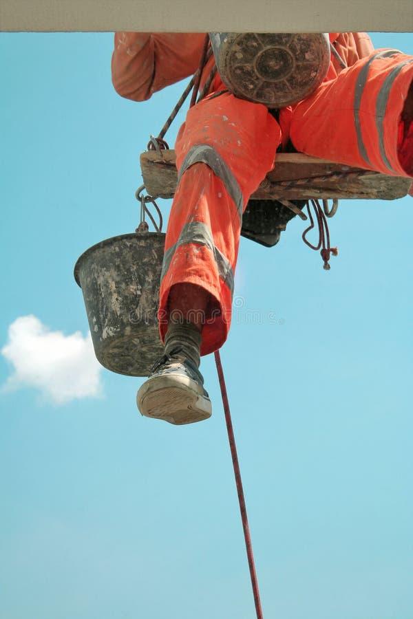 Climbing Worker`s Foot stock photo