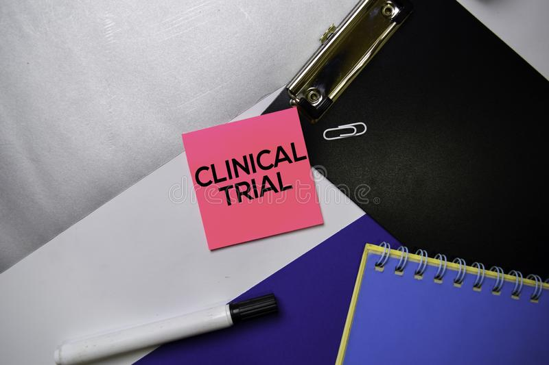 Clinical Trial text on sticky notes with color office desk concept stock photos