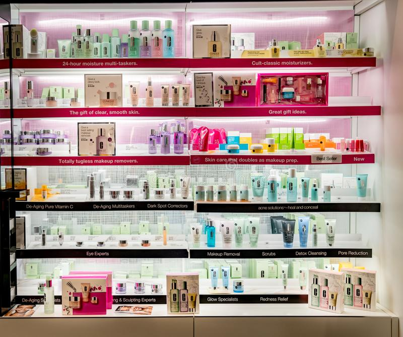 Clinique cosmetics retail display at store. Clinique beauty cosmetic products displayed at department store on lighted shelves stock image
