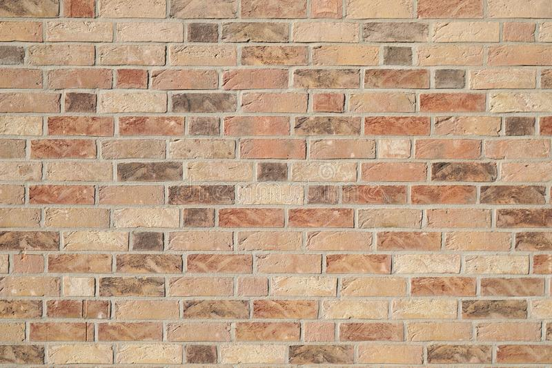 Clinker brick wall background. Brown clinker brick wall background - modern building facade royalty free stock photography