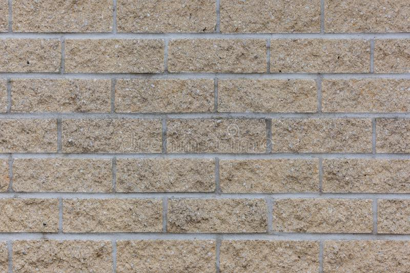 Yellow rough brick wall background stock images