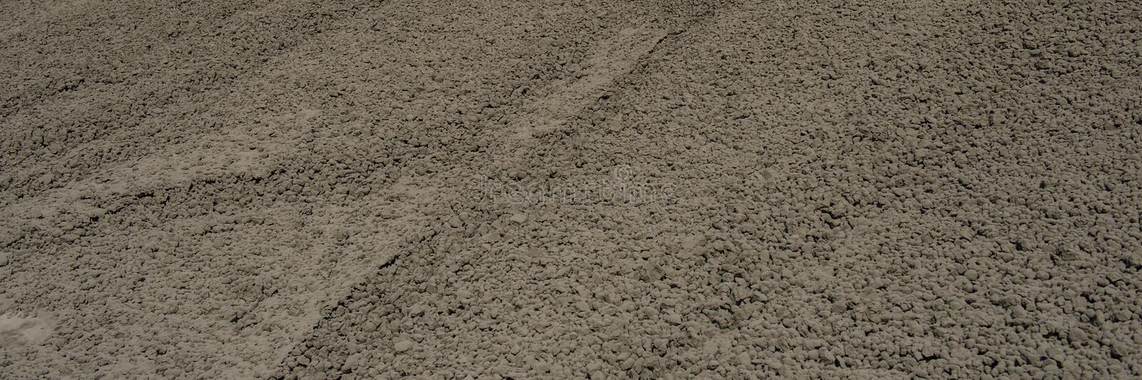 Clinker surface in a raw material warehouse, cement production. Web banner for your design royalty free stock photos