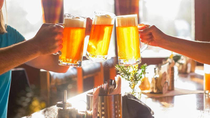 Clinking with Friends using Beer Glass stock photos