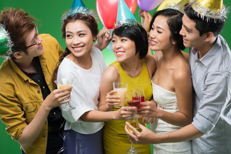 Clinking. Young Vietnamese people clinking at the party stock photo