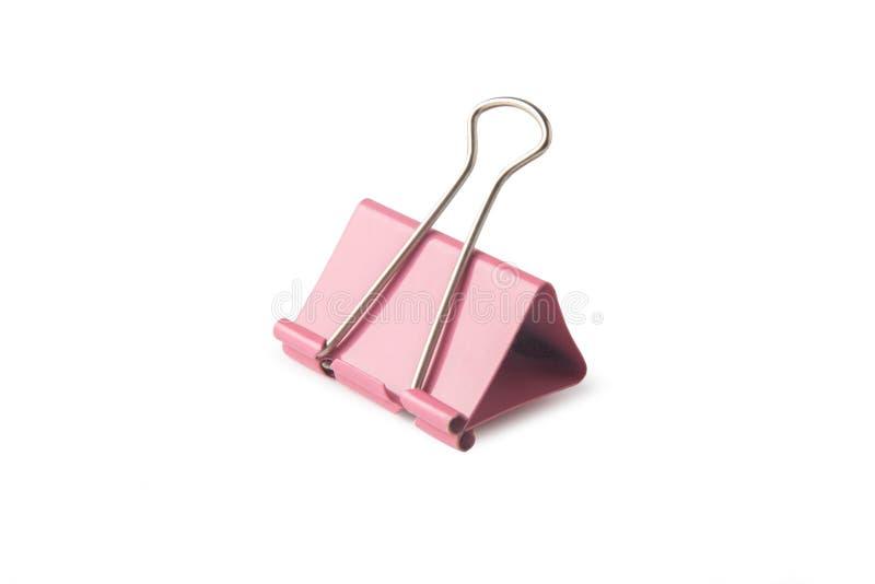 Clip de papel rosado aislado en el fondo blanco con la máscara del recortes foto de archivo