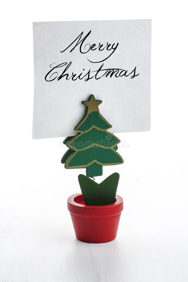 Clip della nota a forma di dell'albero di natale fotografia stock