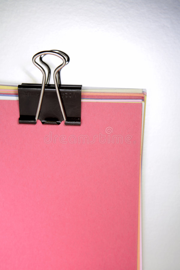 Clip holding paperwork stock images
