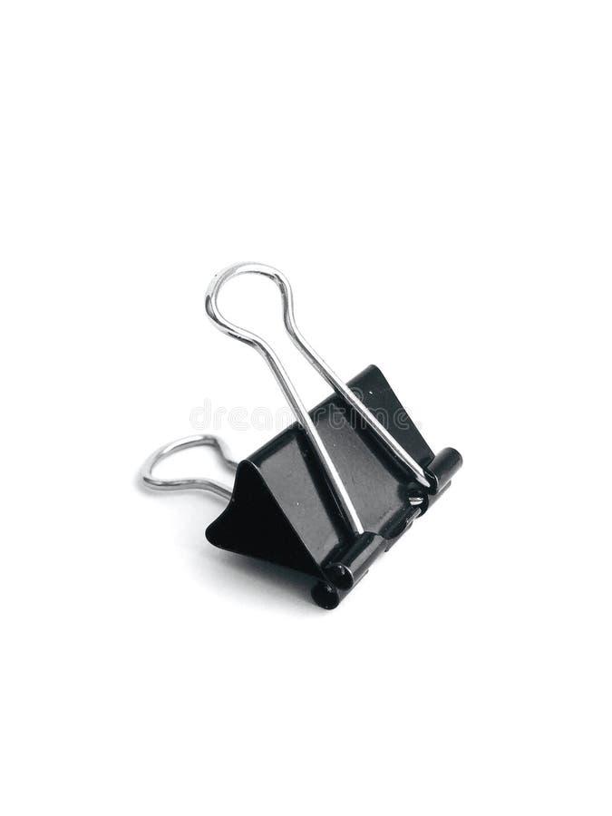 Clip para el negro de papel en un fondo blanco foto de archivo libre de regalías