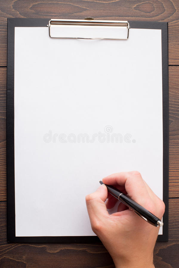 Clipboard with blank sheet of white paper and pen royalty free stock photos