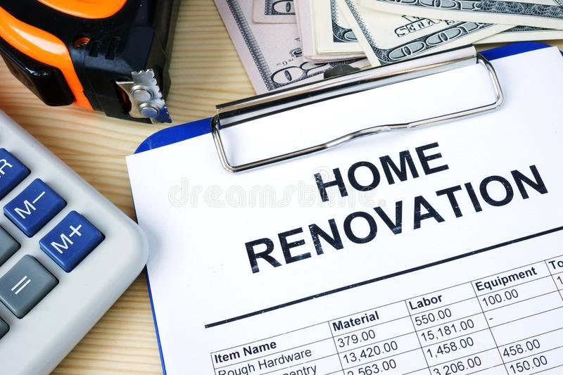 Clipboard with budget calculations about home renovation. Clipboard with budget calculations about home renovation and money royalty free stock photography