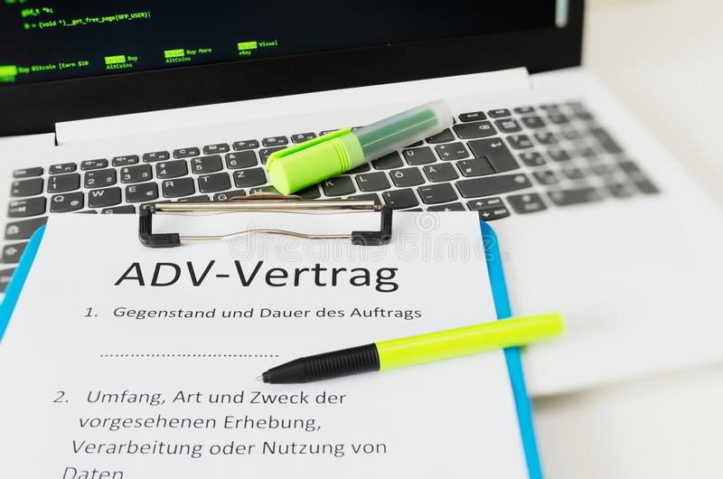 Clipboard with a contract and inscription in german ADV-Vertrag in english ADV contract and subject matter and duration of the con. Tract and scope type and stock photography