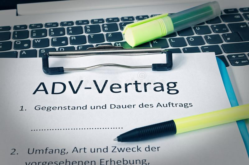 Clipboard with a contract and inscription in german ADV-Vertrag in english ADV contract and subject matter and duration of the con. Tract and scope type and royalty free stock images