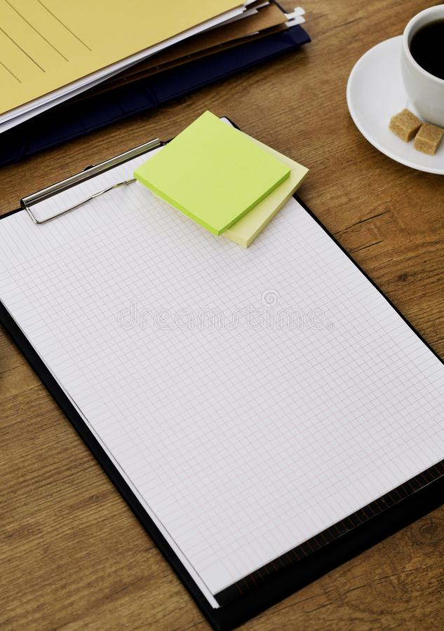 Clipboard on desk royalty free stock image