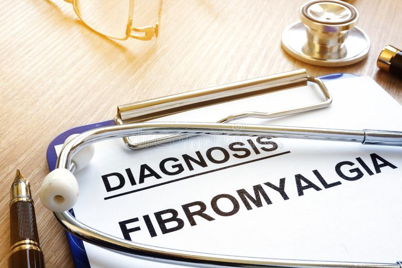 Clipboard with diagnosis fibromyalgia. royalty free stock photography