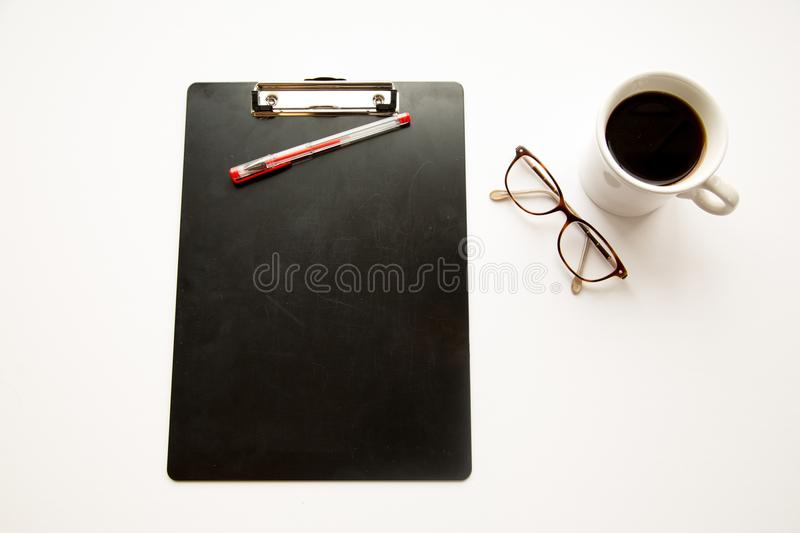 Clipboard, glasses, pens and coffee royalty free stock photo