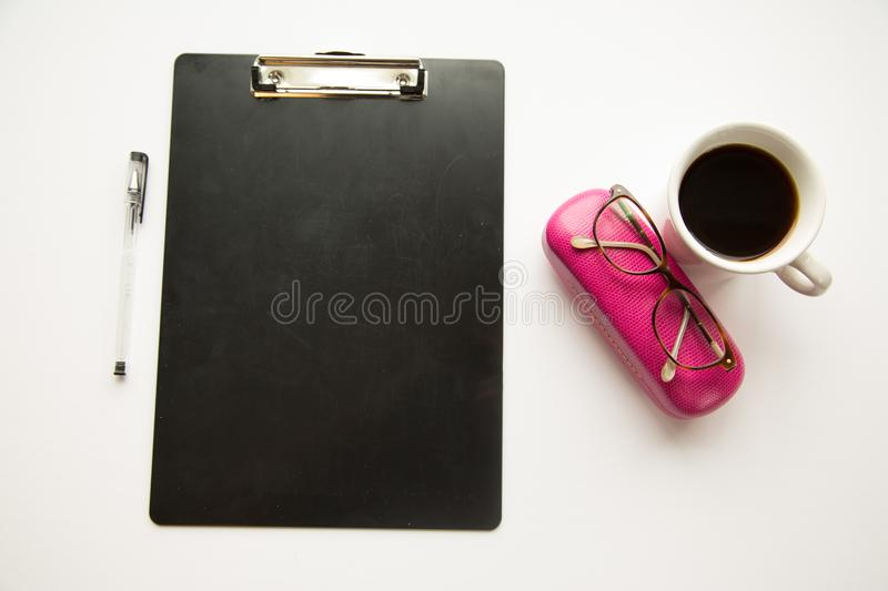 Clipboard, glasses, pens and coffee stock photos
