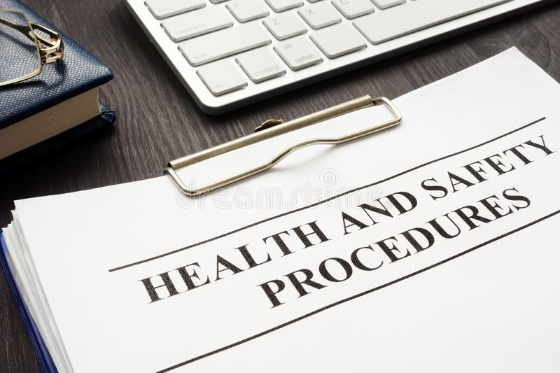 Clipboard with health and safety procedures royalty free stock photos