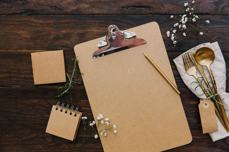 Clipboard mock up with vintage cutlery and wedding flowers. Planning concept. royalty free stock images