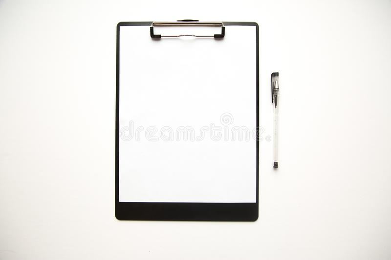 Clipboard and pens on white background royalty free stock photo