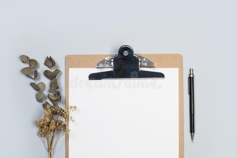 A clipboard table, papers and a pencil stock images
