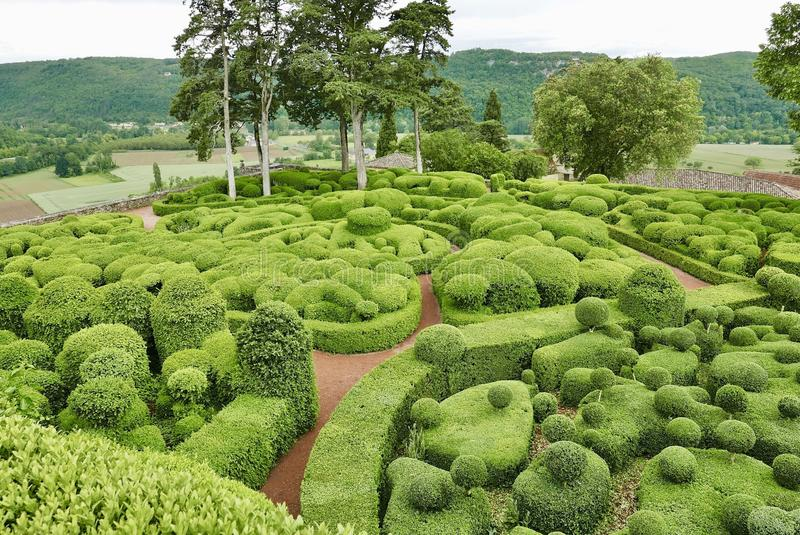 Clipped hedges of Marqueyssac. Chateau Marqueyssac In the Dordogne. Great garden with view over a Dordogne countryside royalty free stock photography