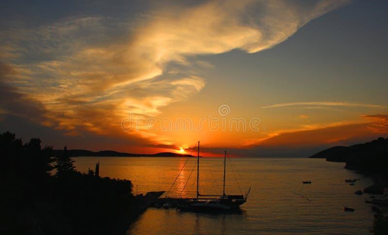 Clipper i solnedgång arkivbilder