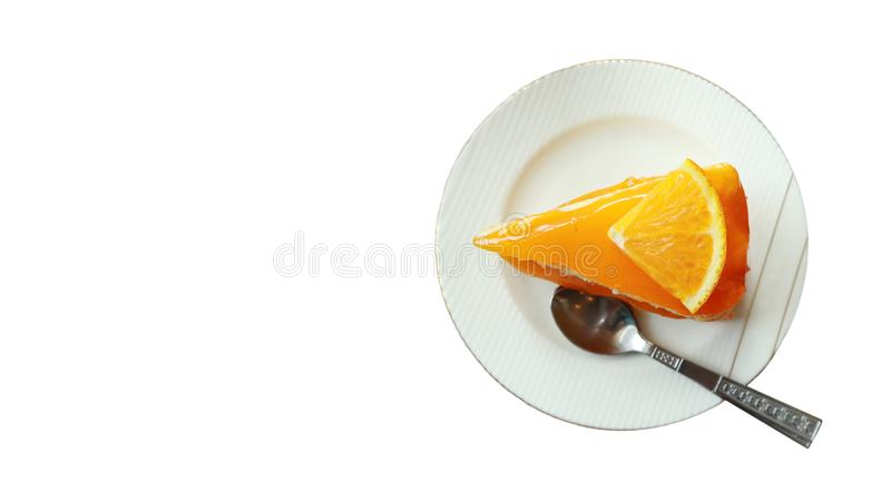 Clipping path and copy space,orange cake on the saucer isolated on white background,tasty sweet dessert on white plate stock photos